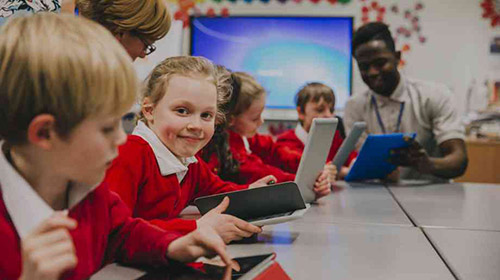 Children using tech in classroom