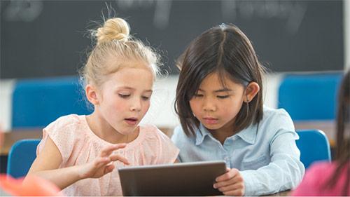 Children using internet on tablet