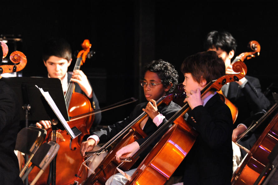Students playing cellos