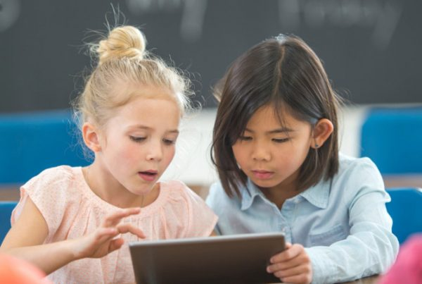 Two children using tablet