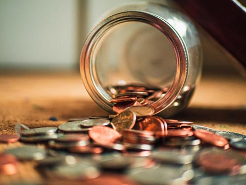 Coins spilling from jar